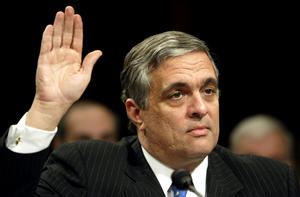 Central Intelligence Agency Director George Tenet is sworn in on Capitol Hill to testify before a session of the national commission investigating the September 11, 2001 attacks, March 24, 2004. The CIA told President George W. Bush and his senior officials before they took office that Osama bin Laden was one of the gravest threats to the United States, according to the national commission investigating the Sept. 11 attacks. REUTERS/Kevin Lamarque  KL